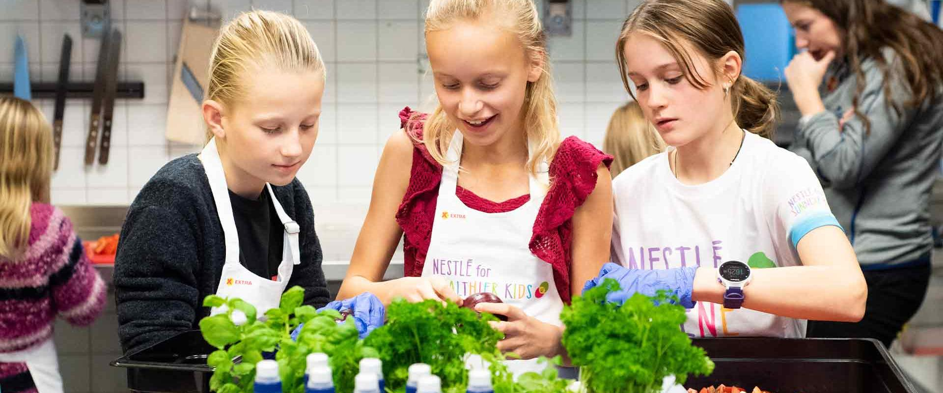 children preparing healthy food